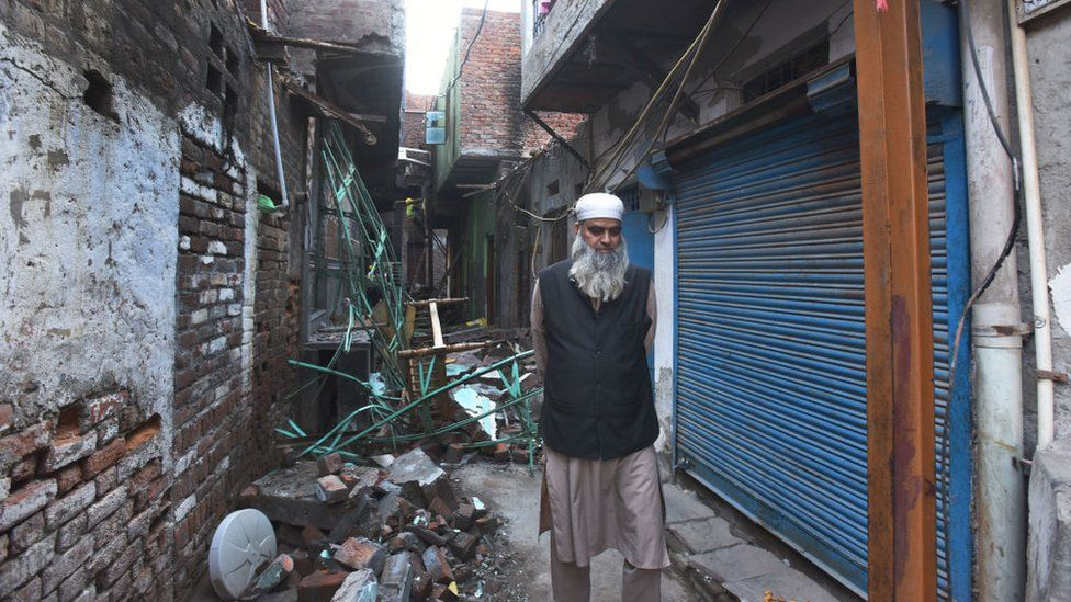 A resident passes by a burnt house after communal violence in northeast Delhi last week over the Citizenship Amendment Act (CAA), at Shiv Viihar, on March 5, 2020
