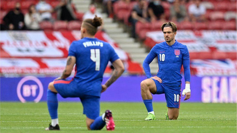 England footballers kneeling before game