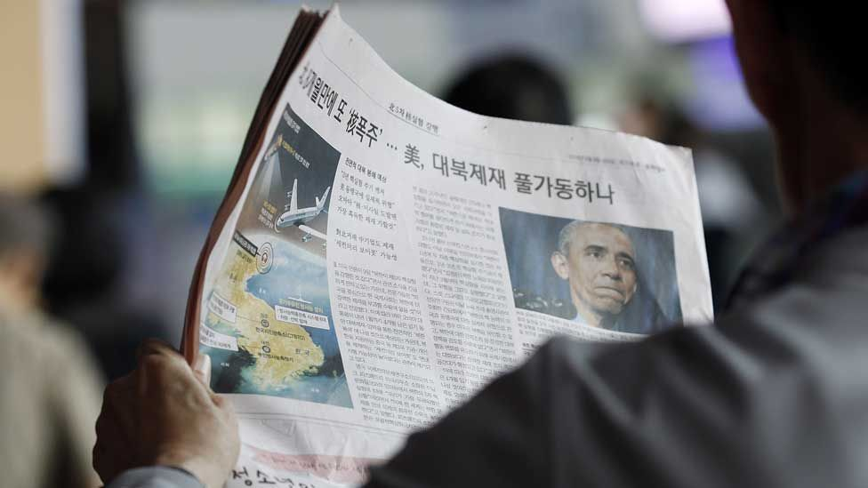 A South Korean reads a newspaper reporting North Korea's nuclear test in Seoul