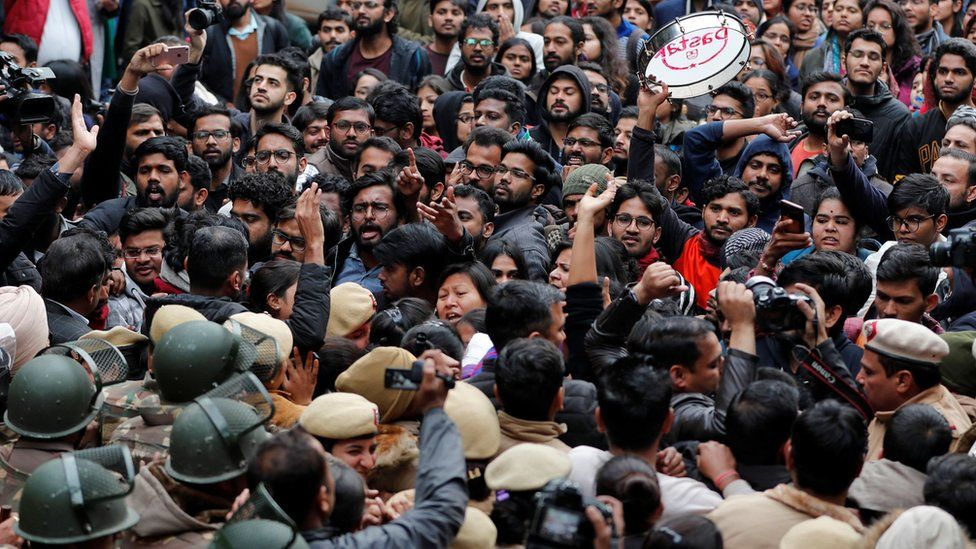Demonstrators attend a protest against the attacks on students of Jawaharlal Nehru University (JNU) on Sunday, on the university campus in New Delhi