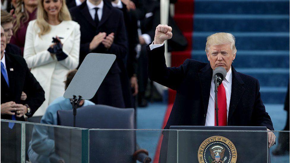 Trump raises fist at inauguration