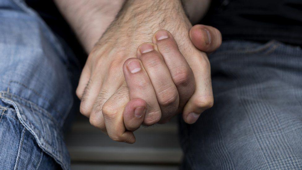 File photo of men holding hands