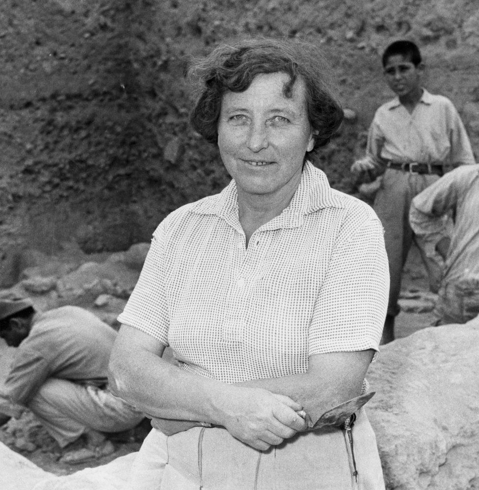Archaeologist Kathleen Kenyon excavating a site in Jericho.