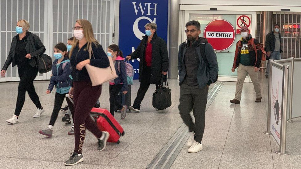 people arriving at airport