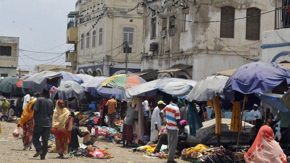 Market vendors sell their wares under umbrellas in Djibouti city