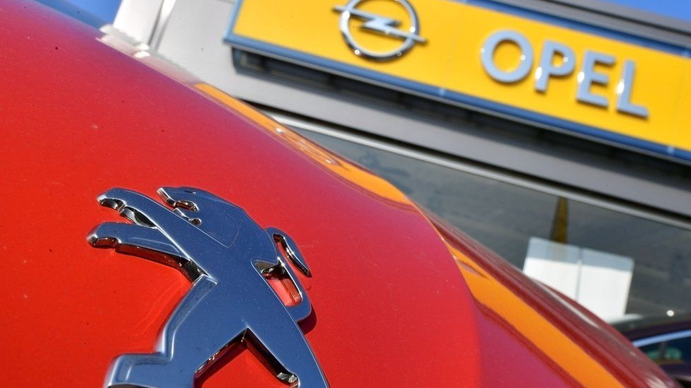 Peugeot and Opel logos