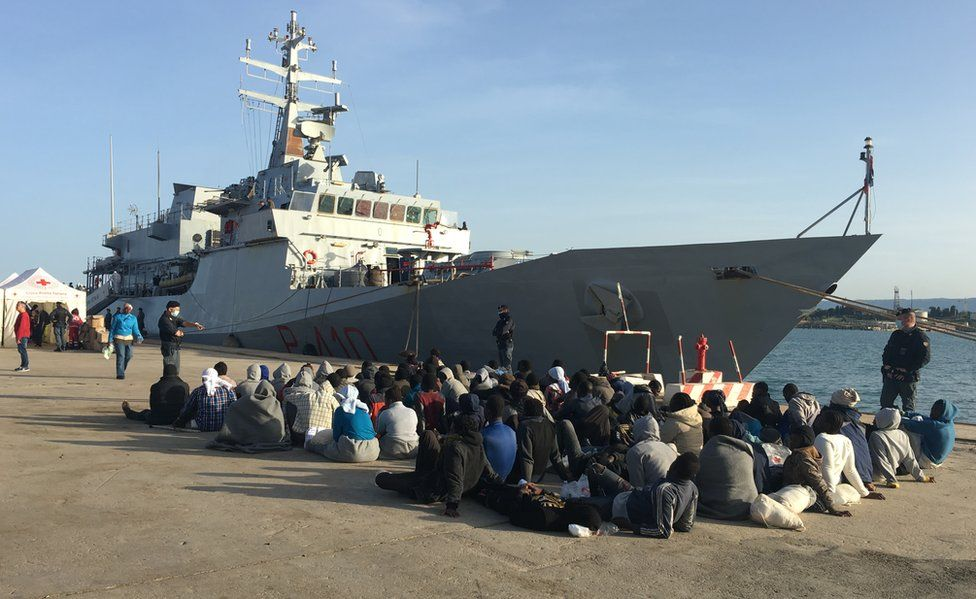 New arrivals wait after arrival in Italy