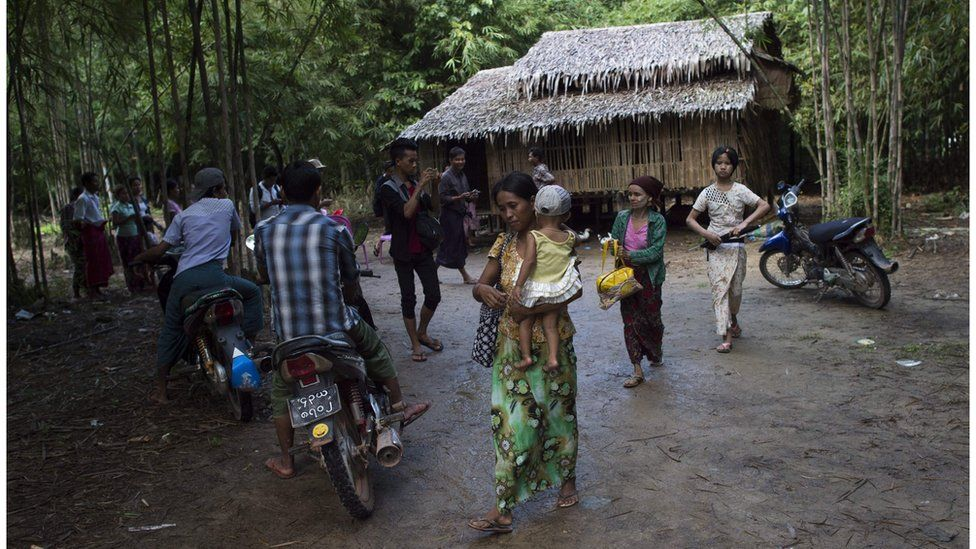 Nyo Nyo Win (centre) the mother of the girls, leaves her village to go to a police station in connection with the case. 20 September 2016.