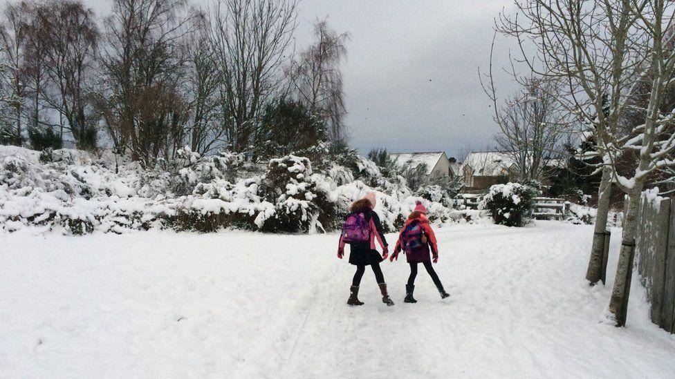 children head to school
