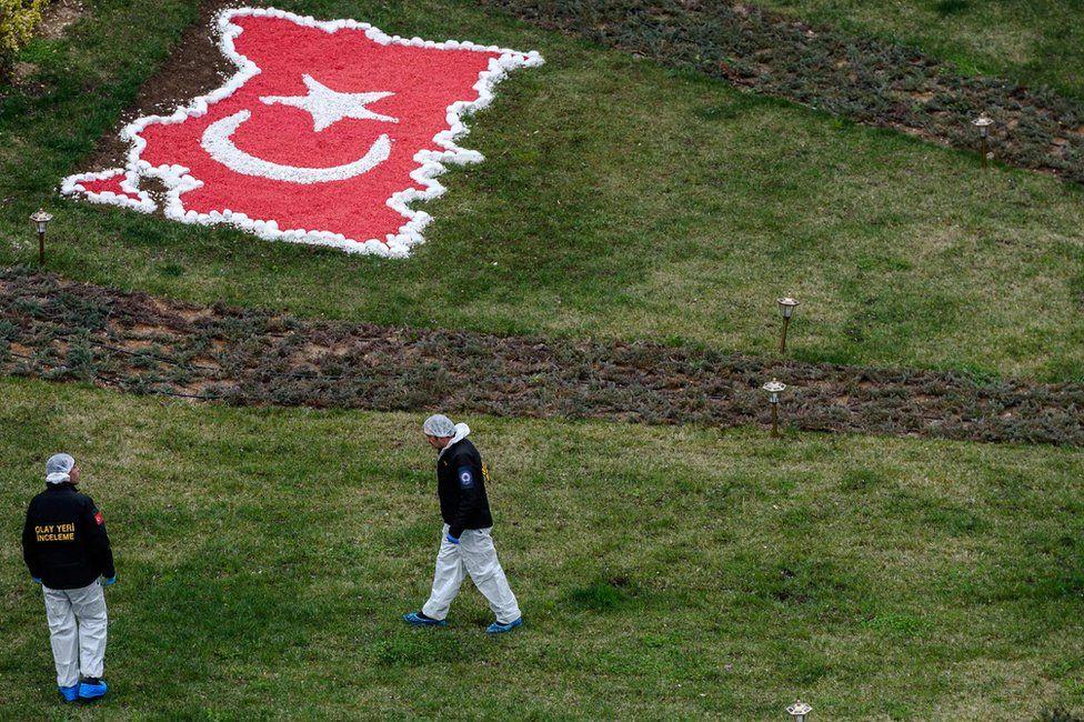 Investigators at the scene of a suicide car bomb in the Turkish capital Ankara