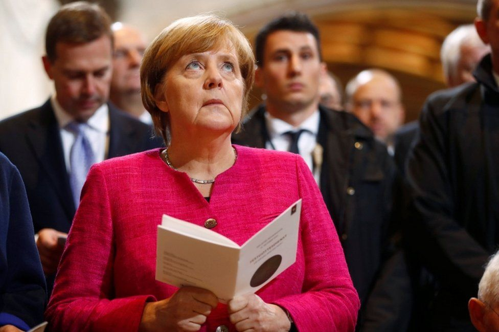 German Chancellor Angela Merkel attends the 500th anniversary of the Reformation in front of the grave of Martin Luther at the Castle Church in Wittenberg, Germany, 31 October 2017