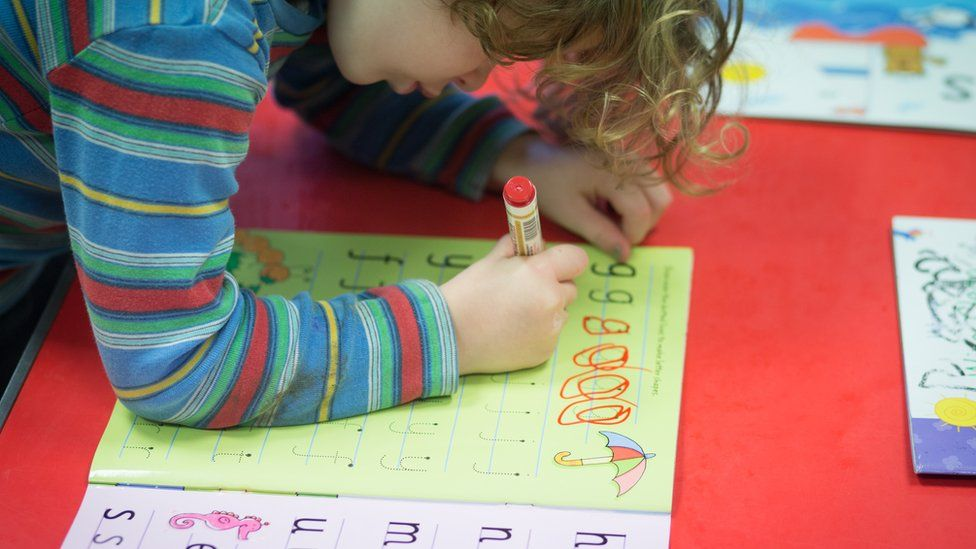 Child writing letters at nursery