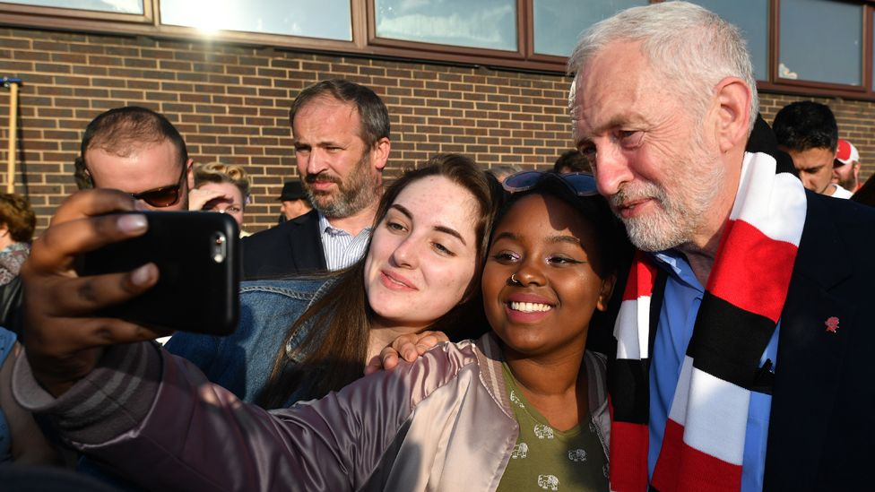 Labour Party leader Jeremy Corbyn takes selfie photo with supporters after being presented a Rotherham United F.C. scarf during a campaign event on May 10, 2017 in Rotherham, England.