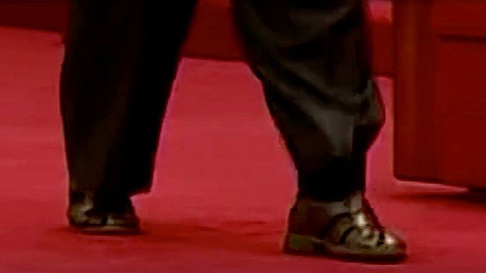 North Korean leader Kim Jong-un wears sandals and socks at a military exhibition