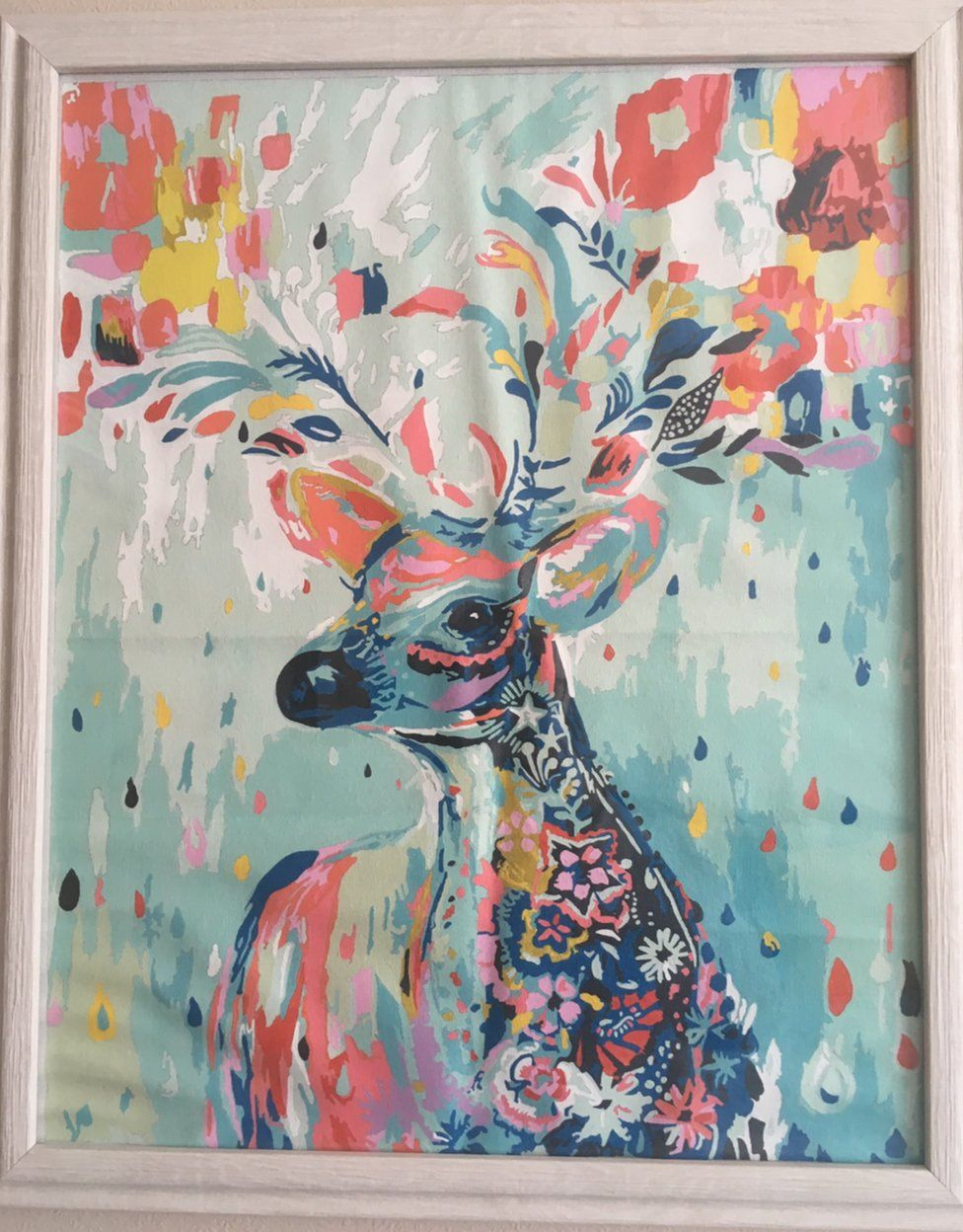 A multicoloured image of a deer created using a painting-by-numbers set