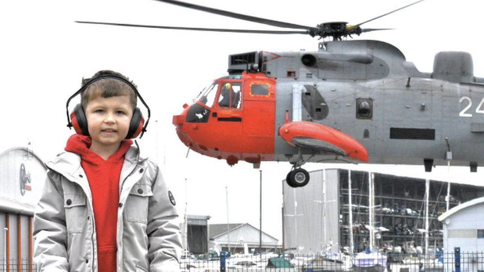 Finley Eckersley with Sea King helicopter