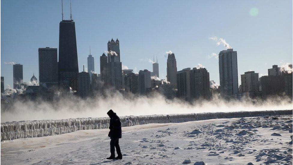 A man walks along the lakefront in Chicago