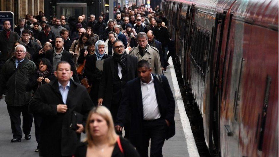 Passengers on rail platform