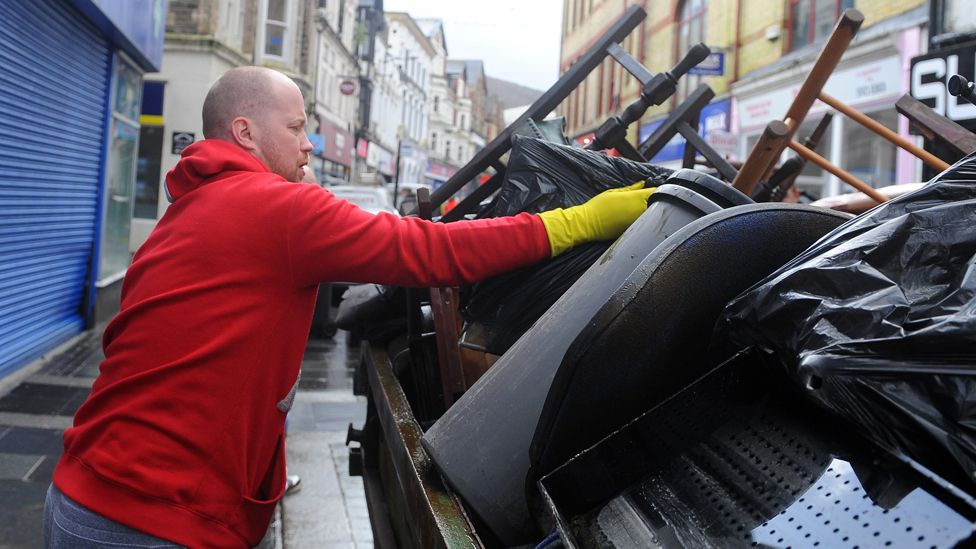 Clearing up in the centre of Pontypridd on Monday