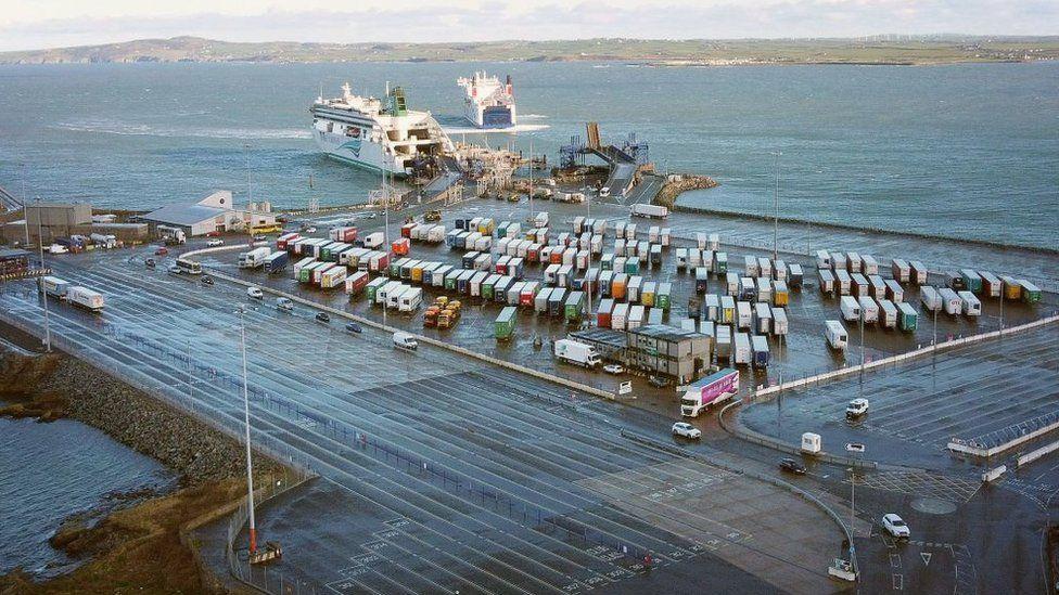 Irish ferries roll on roll off ferry Ulysses unloads as Stena Adventurer arrives in Holyhead port on 2 January