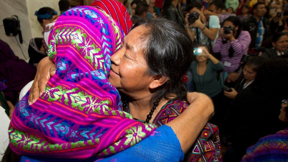 Human Rights activist Rosalina Tuyuc embraces a victim of sexual violence in court in Guatemala city on 26 February, 2016