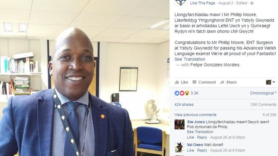 Barbadian surgeon Phillip Moore has received praise for passing his Advanced Welsh language exams