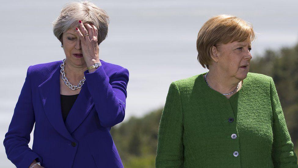 Theresa May and German Chancellor Angela Merkel at the G7 summit in Canada
