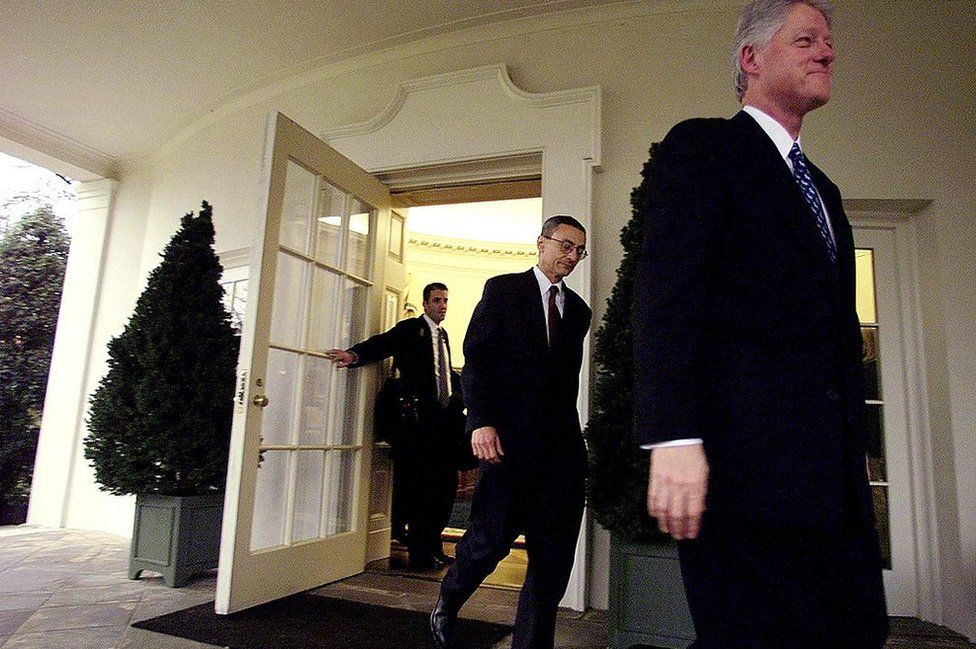 Doug Band and John Podesta leave the oval office on Bill Clinton's last day as president