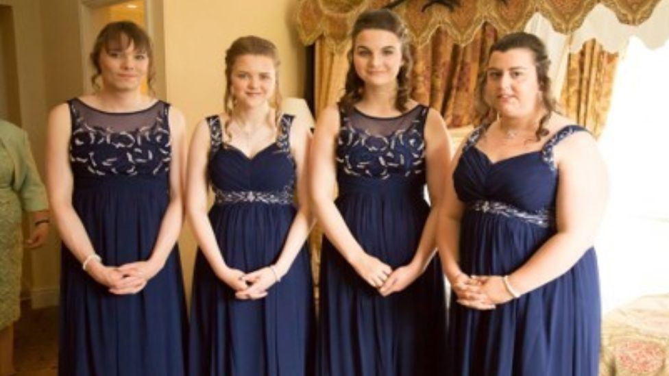 Stacy Winson as a bridesmaid with others, at her sisters' wedding