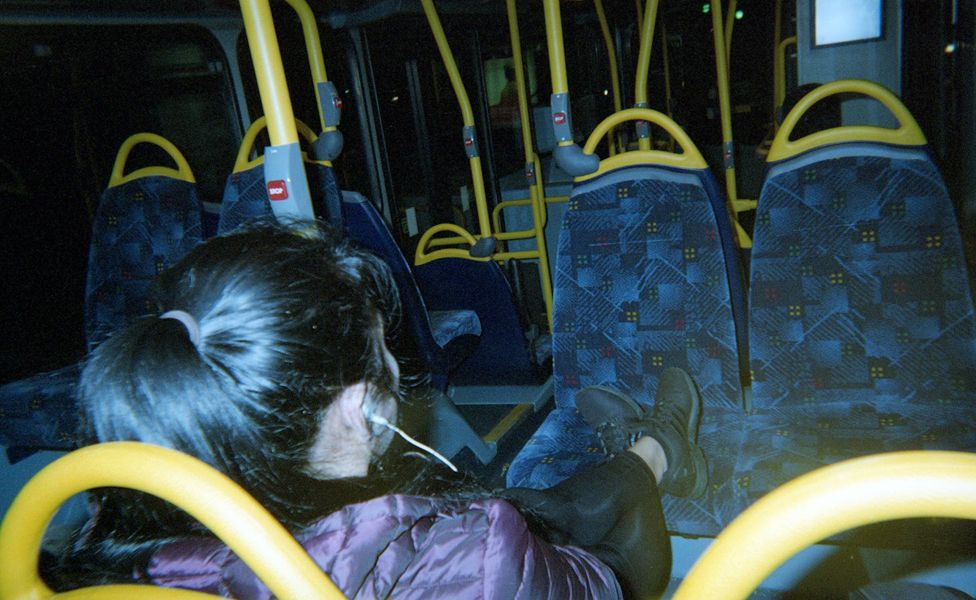 A bus passenger and rows of empty seats