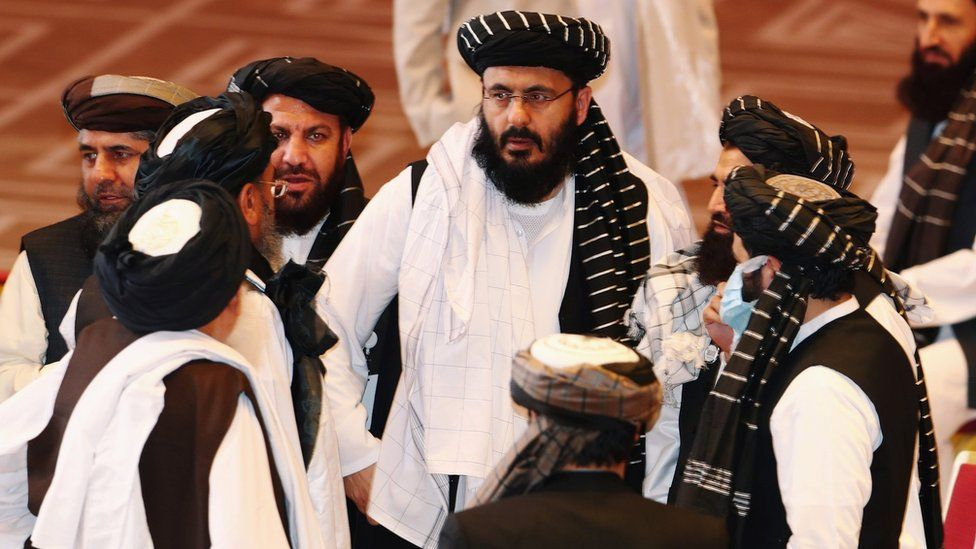Taliban delegates speak during talks between the Afghan government and Taliban insurgents in Doha, Qatar September 12, 2020