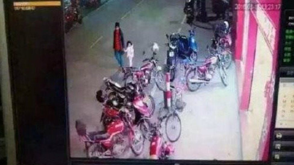 A security camera image showing the girl being abducted, published on social media by Chinese police