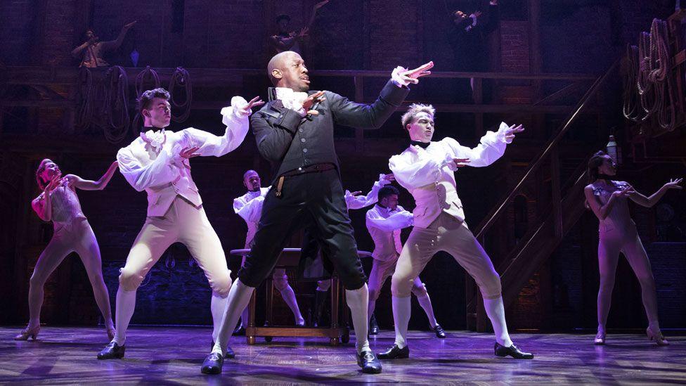 Giles Terera (centre) as Aaron Burr in Hamilton