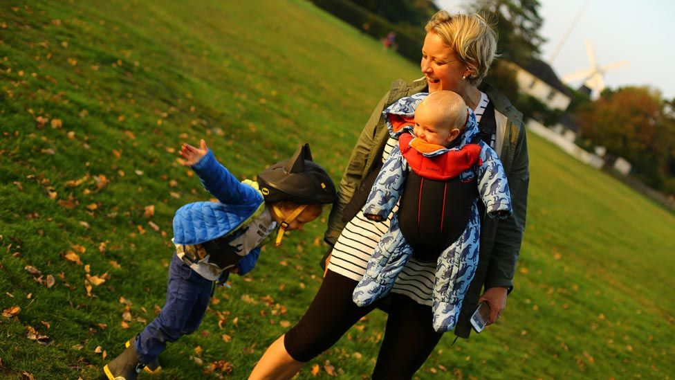 Alexandra Vanotti smiling in the park with her children