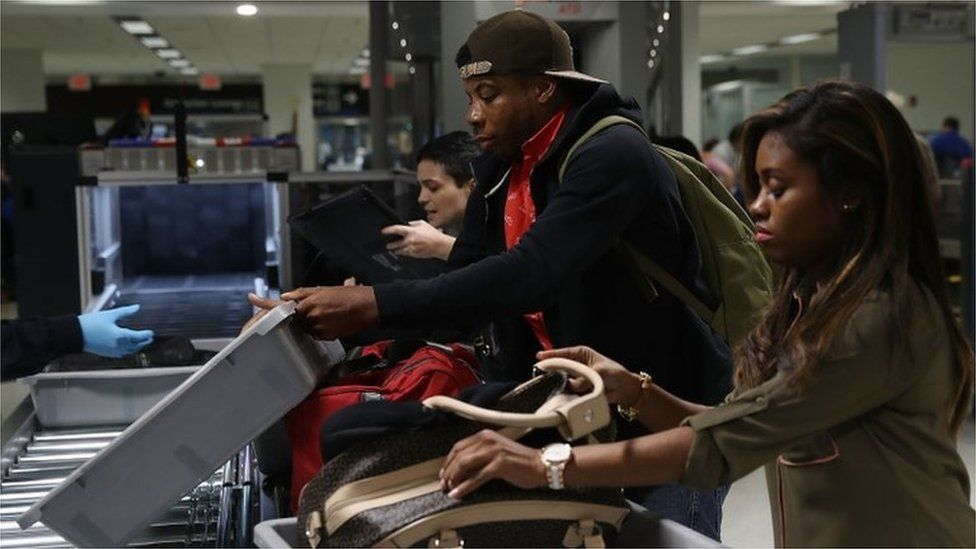 Passengers at an airport security screening