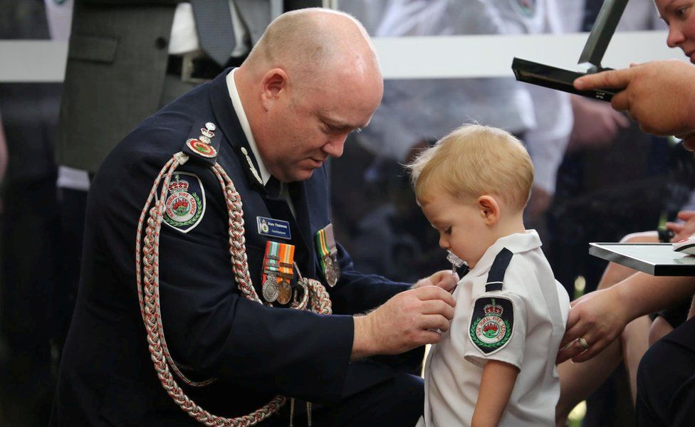 This photo of the commissioner and 19-month-old Harvey Keaton was widely shared online