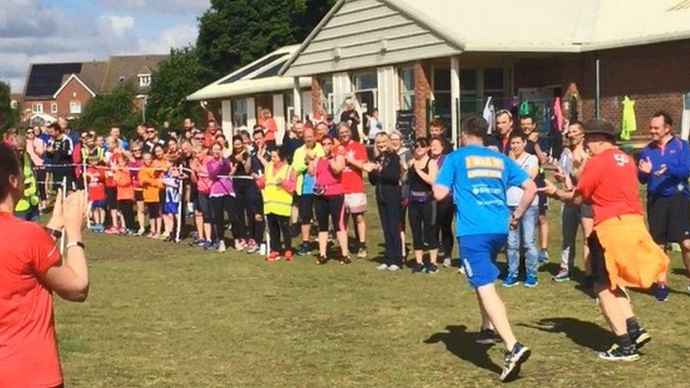 Ben Parker (blue) finishing Kesgrave parkrun