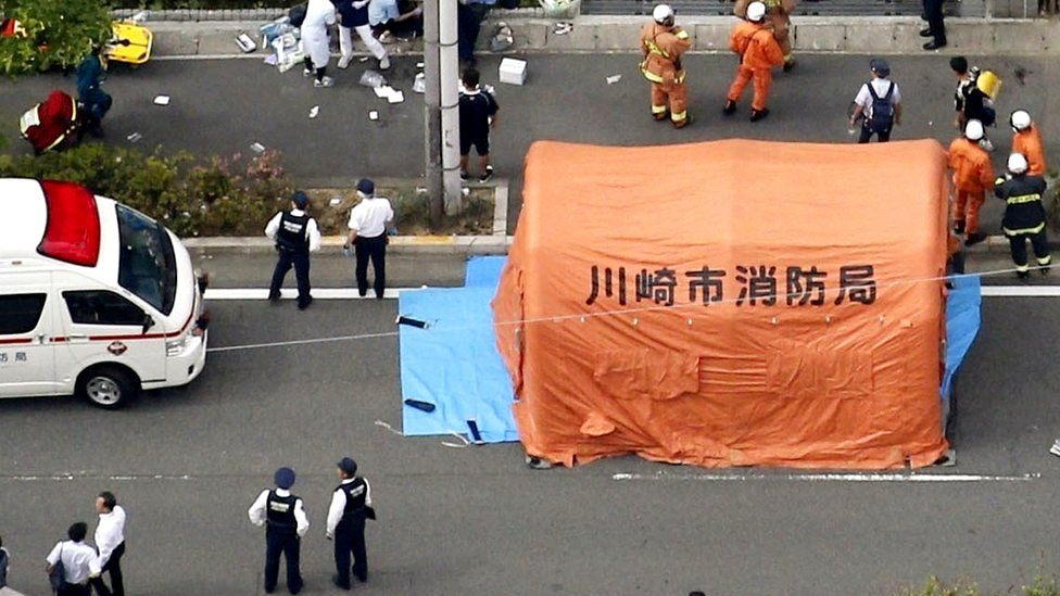 An aerial view shows rescue workers and police officers operate at the site where sixteen people were injured in a suspected stabbing by a man, in Kawasaki, 28 May 2019