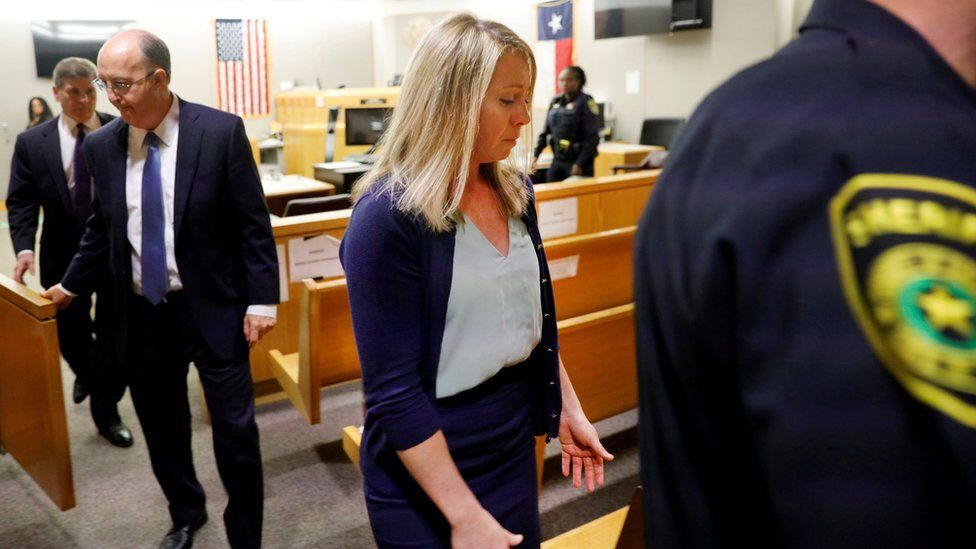 Former Dallas police officer Amber Guyger is escorted from the courtroom after she was found guilty of murder