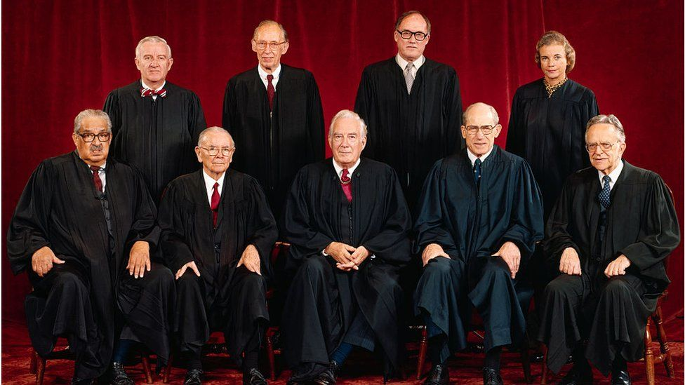 Rehnquist and Mrs O'Connor stand beside each other (back row right) in this 1982 photo