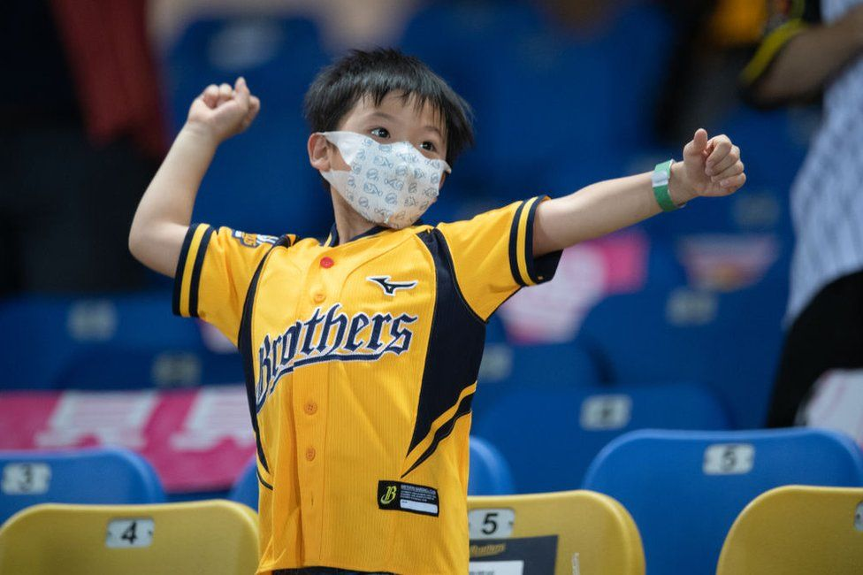 Young fans reacts to a score during the CPBL game between CTBC Brothers and Rakuten Monkeys at the Taichung Intercontinental Baseball Stadium on May 10, 2020 in Taichung, Taiwan.