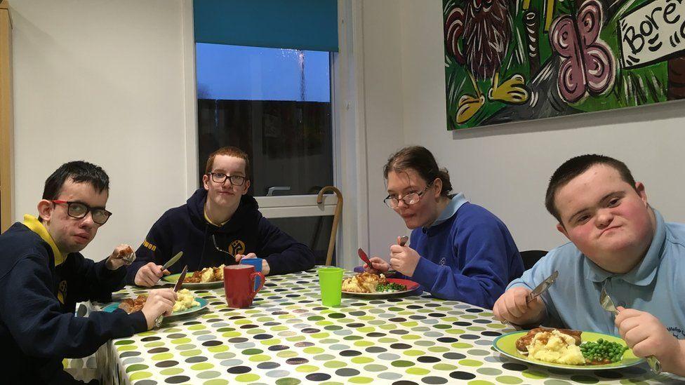 L-R Rhodri, Jac, Portia, Ben eating supper at Hafan y Sêr, Penrhyndeudraeth, Gwynedd