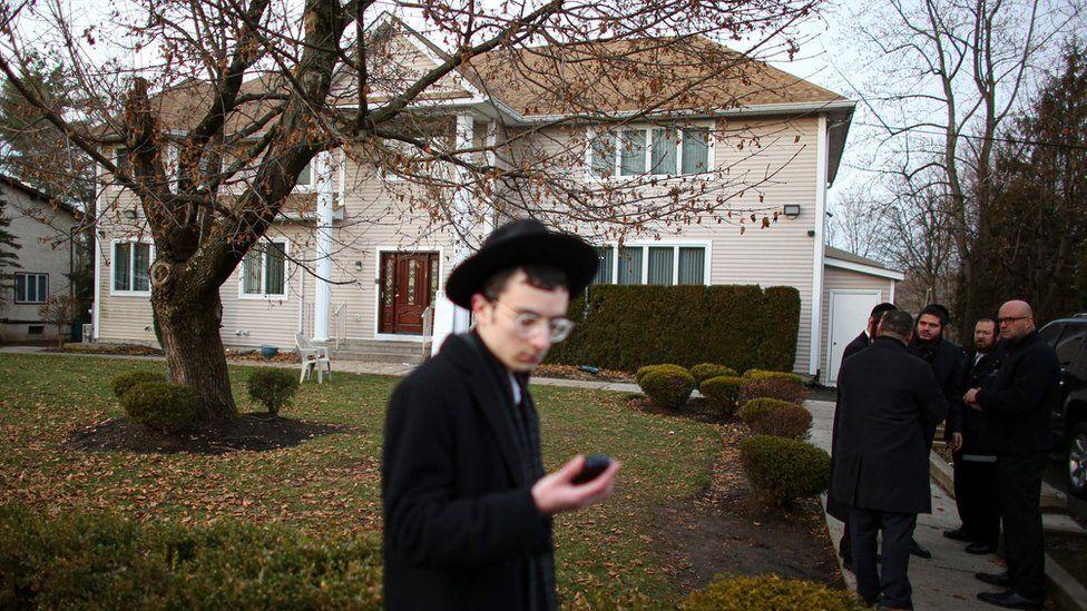 man outside rabbi's house