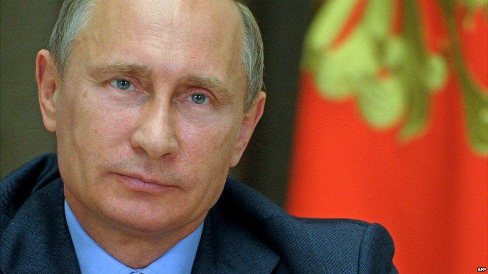 Russian President Vladimir Putin at his residence outside Sochi - 9 August 2014