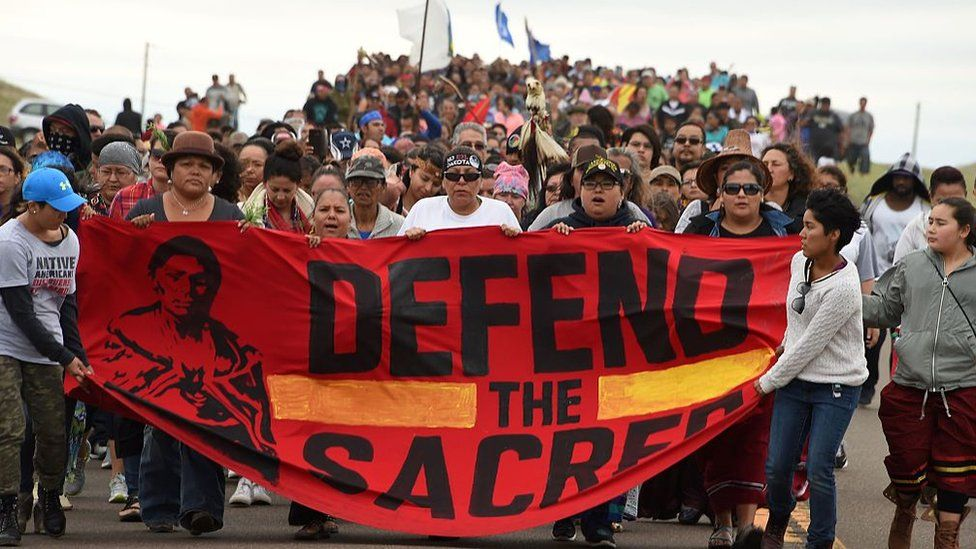 Native Americans march to the site of a sacred burial ground that was disturbed by bulldozers building the Dakota Access Pipeline (DAPL), near the encampment where hundreds of people have gathered to join the Standing Rock Sioux Tribe's protest of the oil pipeline slated to cross the nearby Missouri River, September 4, 2016 near Cannon Ball, North Dakota