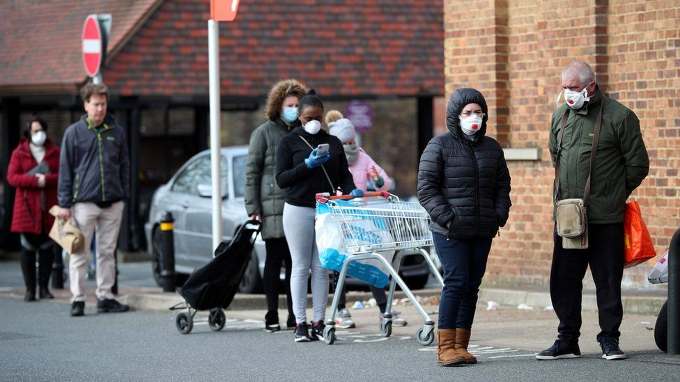 People queuing outside a supermarket in Streatham