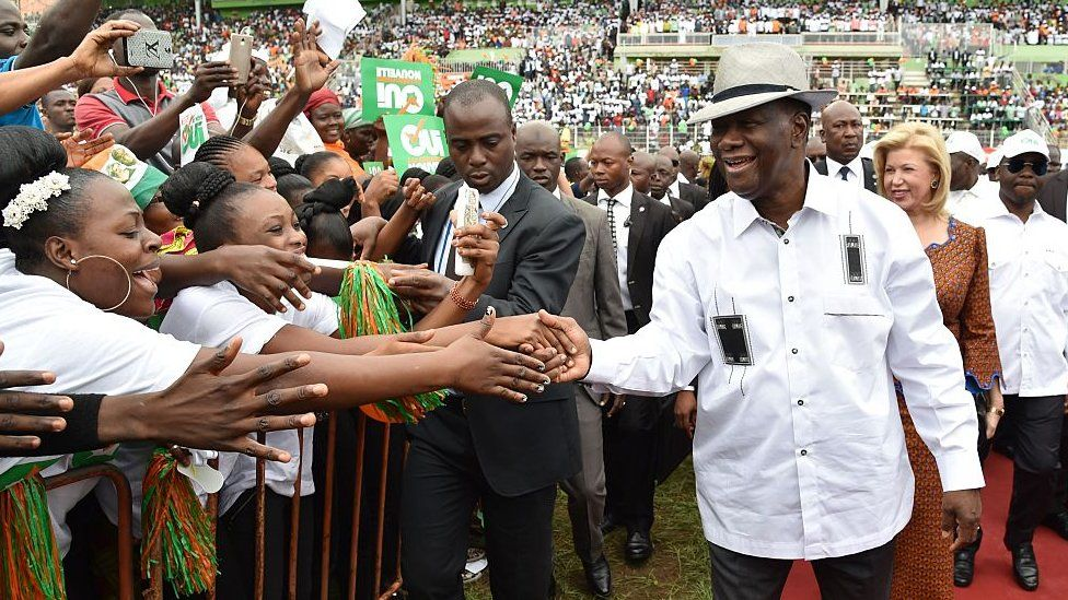 Ivory Coast president Alassane Ouattara speaks greets supporters at a rally for the new constitution
