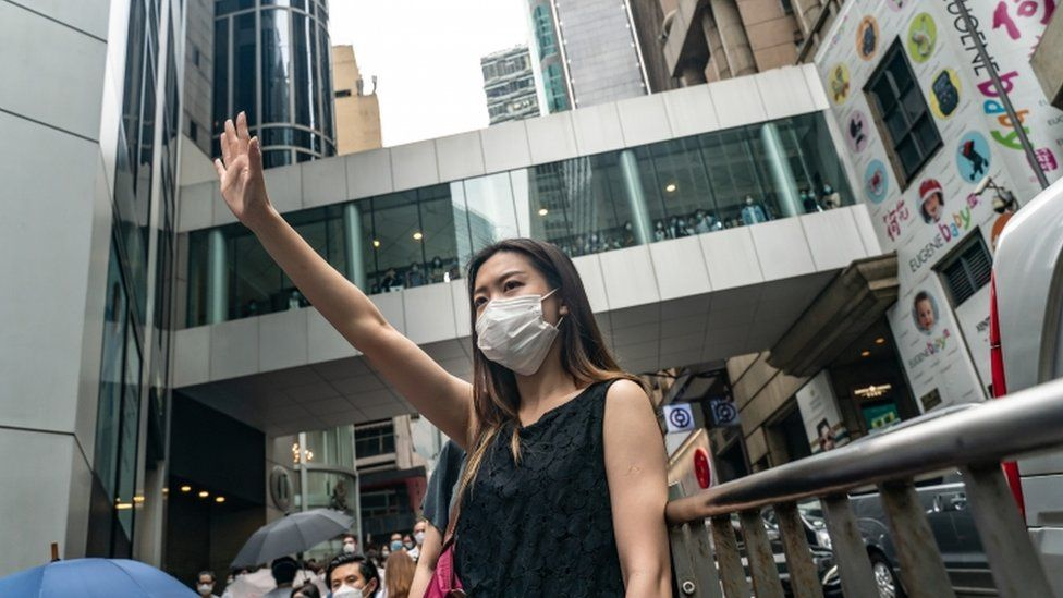 Pro-democracy supporters shout slogans in the Central district