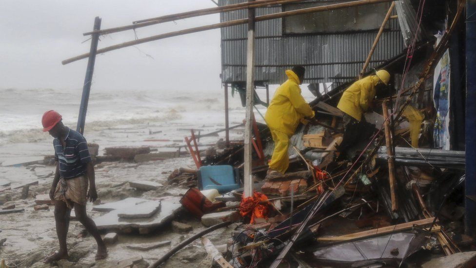 Rescue workers search for survivors after a cyclone in Bangladesh