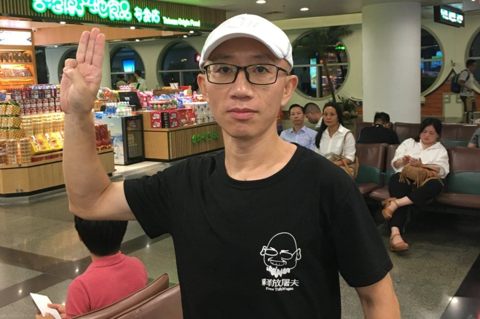 Picture of Chinese activist Hu Jia wearing a T shirt calling for the release of blogger Wu Gan